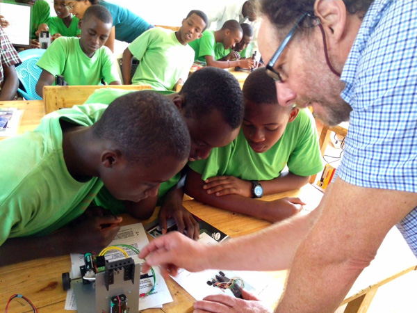 A volunteer from Engineers Without Borders leads a student science project to program a small buggy... and to everyone's delight the buggy ran successfully.